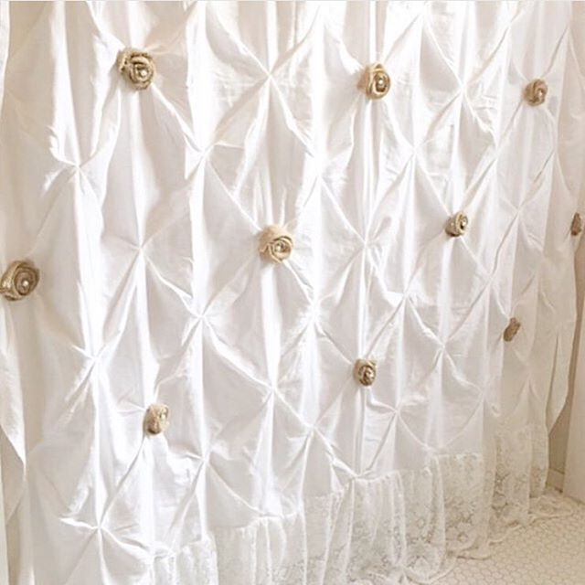 white tufted shower curtain with burlap roses and lace at the bottom