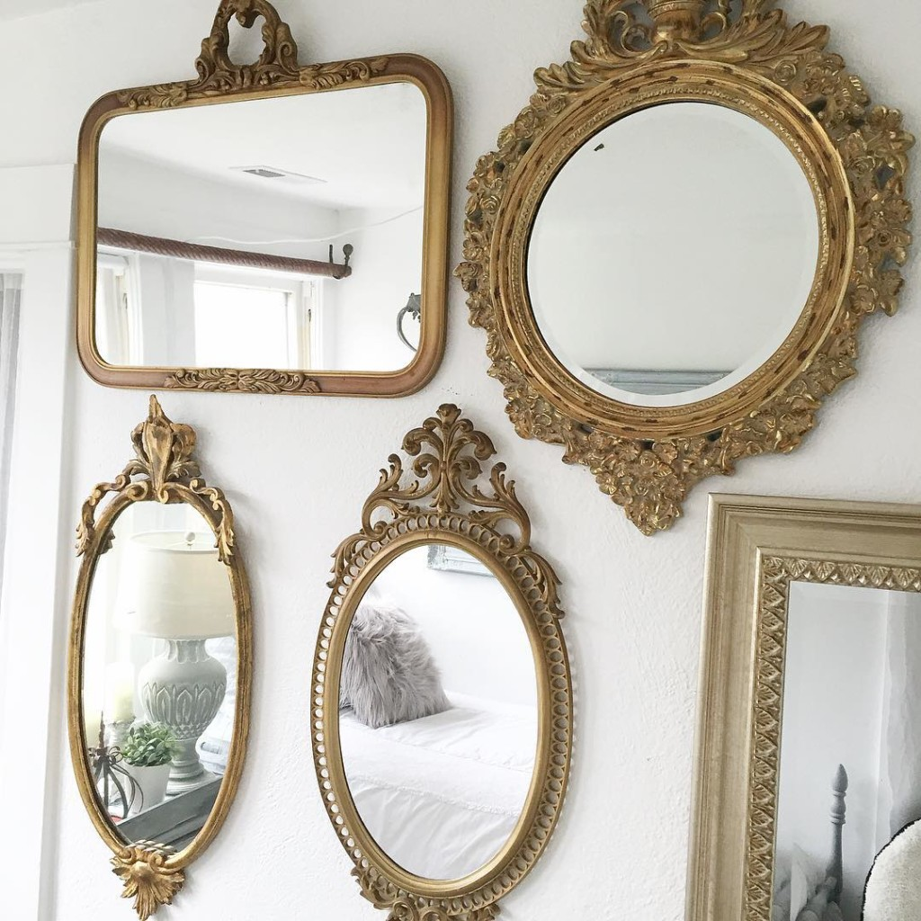 5 gold ornate mirrors creating a gallery wall