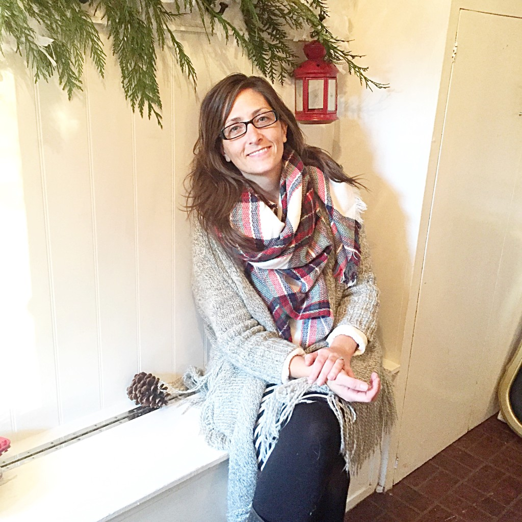 Rhonda Hallstrom Sitting in mudroom with a garland behind her