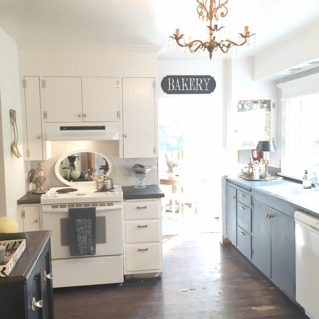 farmhouse kitchen with large bakery sign and gold chandelier