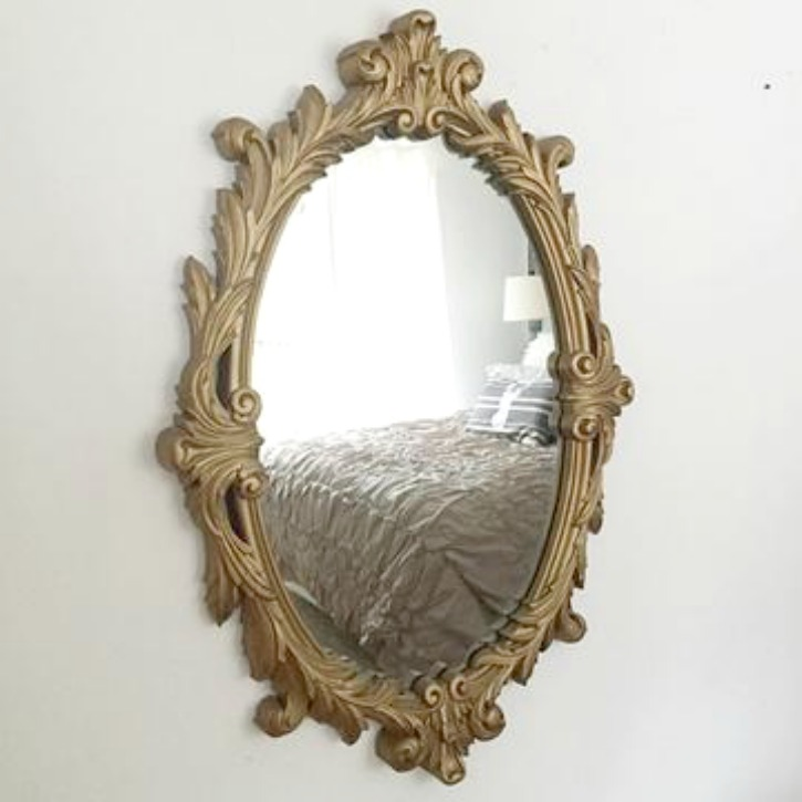 Ornate Large Gold Mirror hanging on empty wall