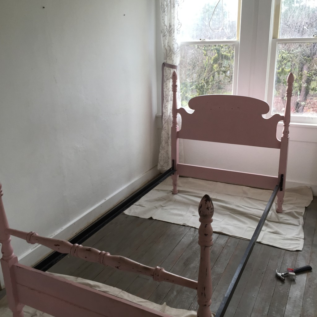 empty pink twin size bed frame
