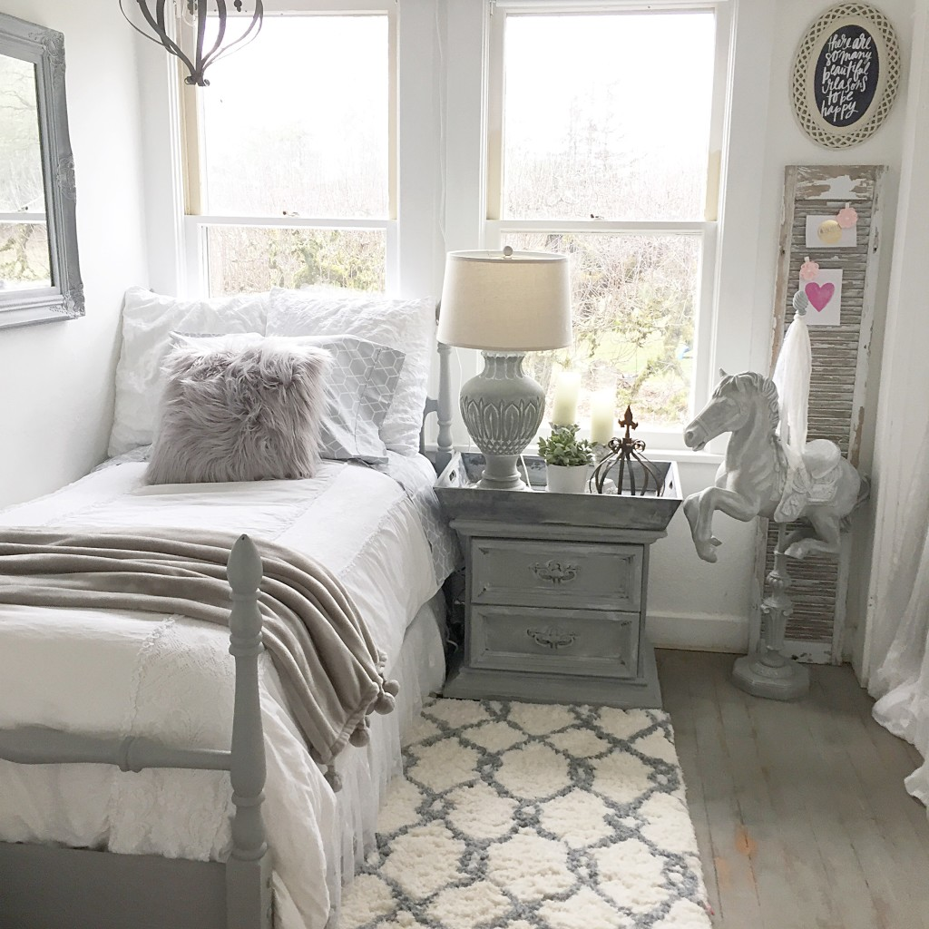 grey girls room with twin size bed and grey fur pillow and grey night stand