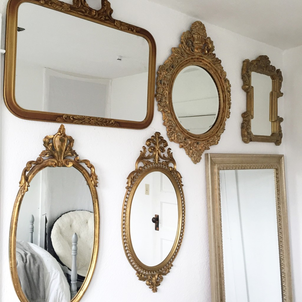 6 vintage gold ornate mirrors hanging on wall