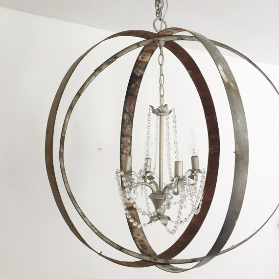 metal orb hanging ceiling light with crystal chandelier in the middle