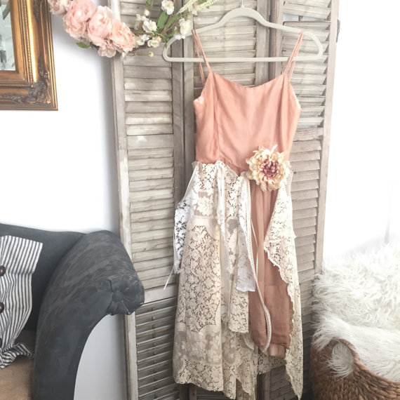 pink and white lace dress hanging on old antique shutters