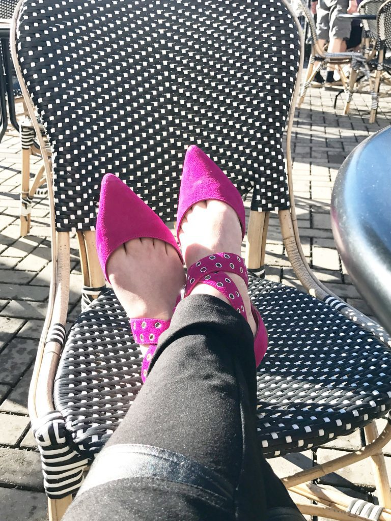 DIY tissue paper flowers tutorial pink pointed wrap around flats. legs crossed resting on black and white chair