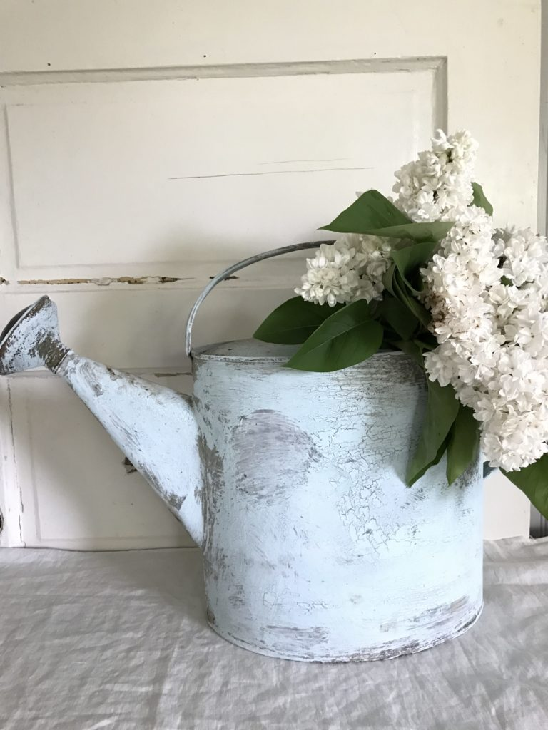 DIY Chippy Paint Watering Can - See this tutorial on how to get ths farmhouse look on your own. Perfect paint technique to age a newer item to look vintage.