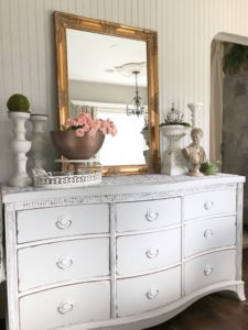 grey dresser with gold mirror and 4 candle holders