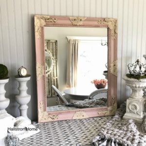 pink and white ornate mirror
