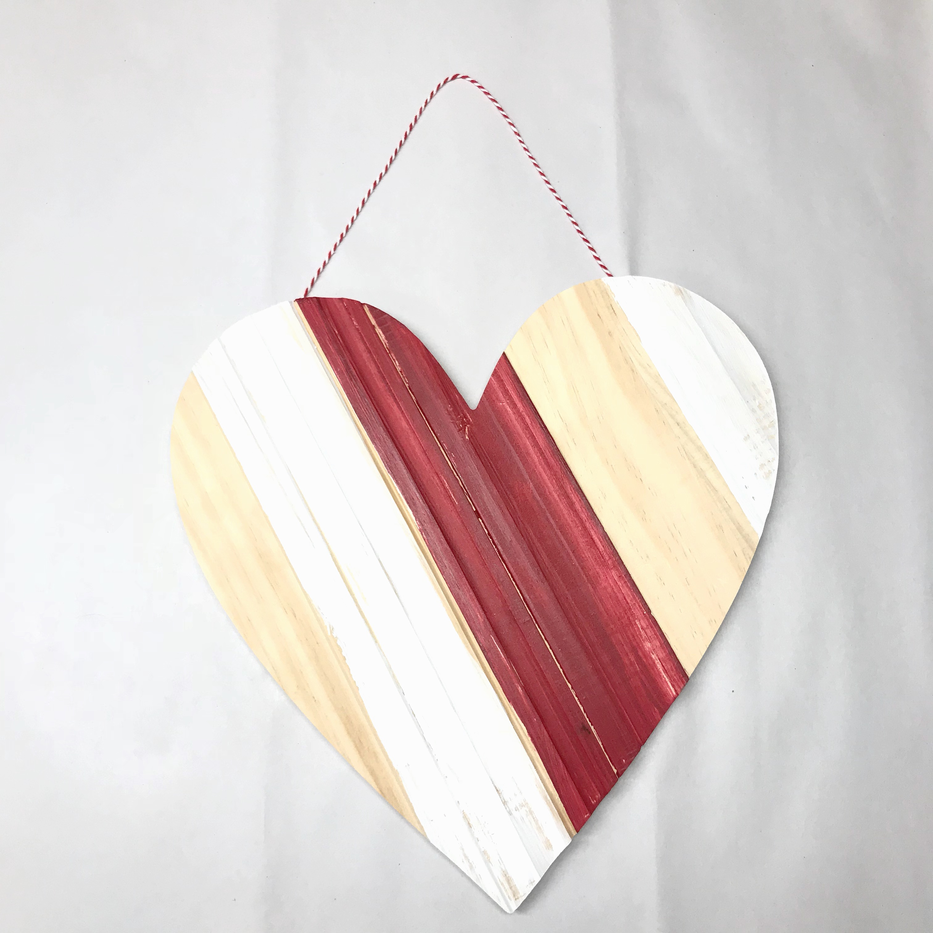 Striped heart shaped wall hanging