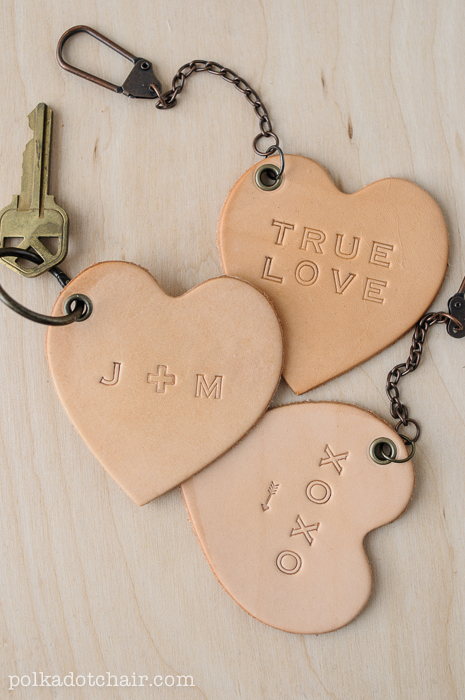 3 leather key chain hearts that say true love, xoxo, j and m