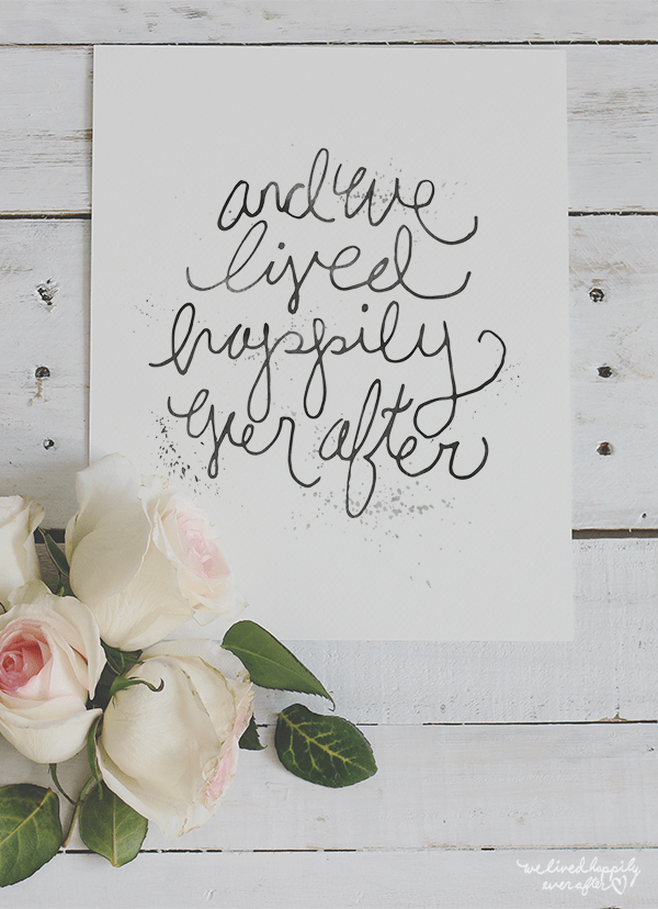 scroll wall print that says and we lived happily ever after with 4 white roses on bottom left