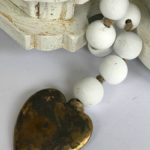 white wood beads strand with metal heart