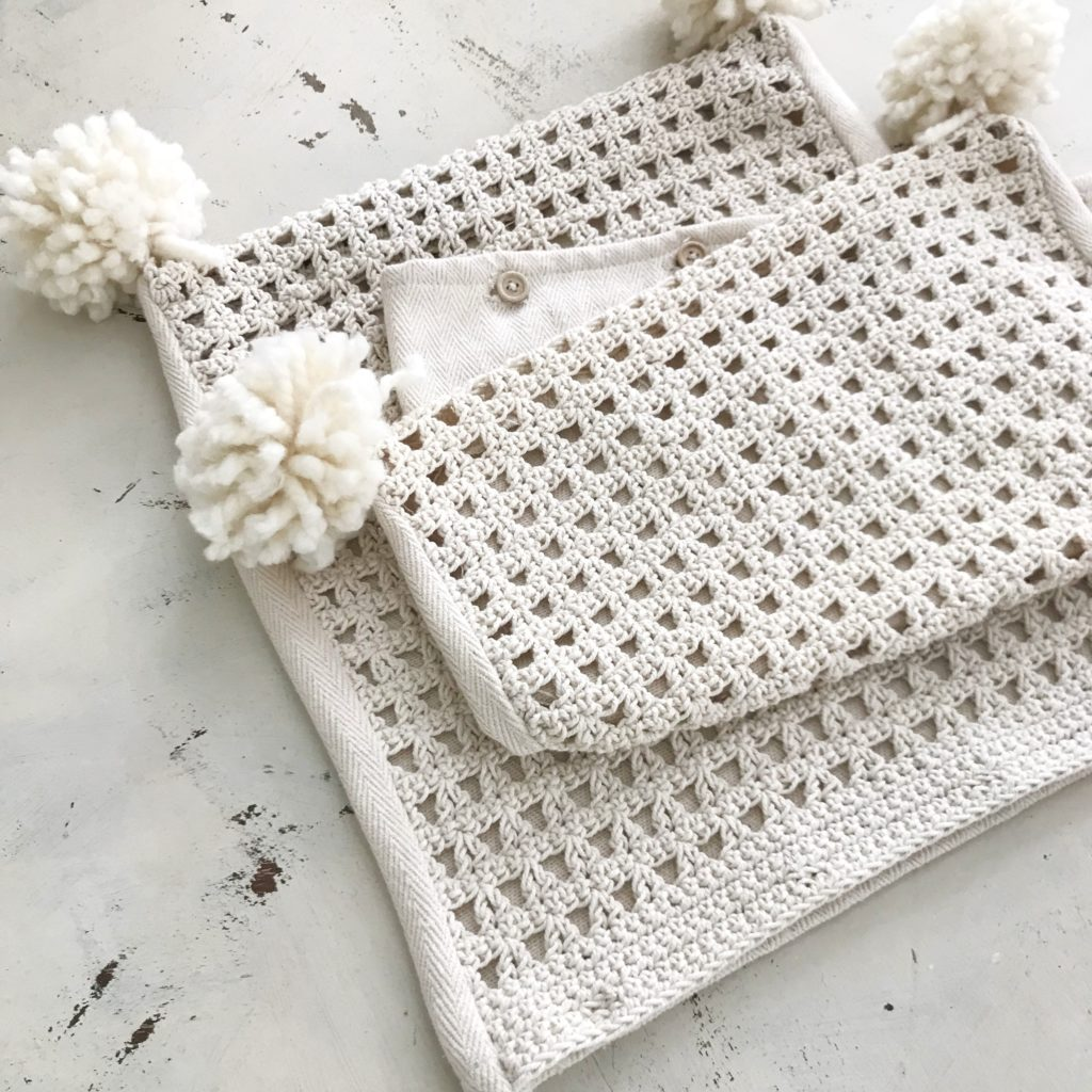 cream knit pillow cases with white pom poms on the corners