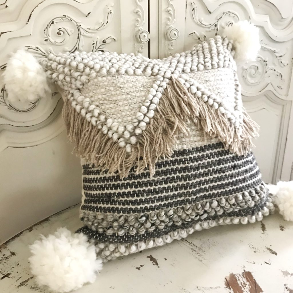 Wool Pom Pom Tutorial for Crafts chunky knit pillow cream and brown with light brown tassels and white pom poms on corners