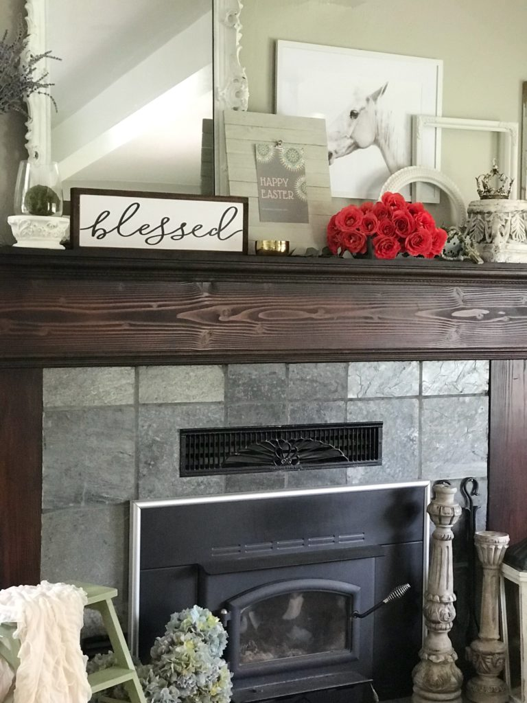 mantel with happy easter sign and blessed scroll sign with bouquet of red roses with large white mirro