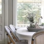 Breakfast Room Table Makeover / Chalk Paint Recipe white farmhouse table with 3 blue and white chairs with woodent tray ontop filled with lavender wreatha dn whtie corbel with cloche