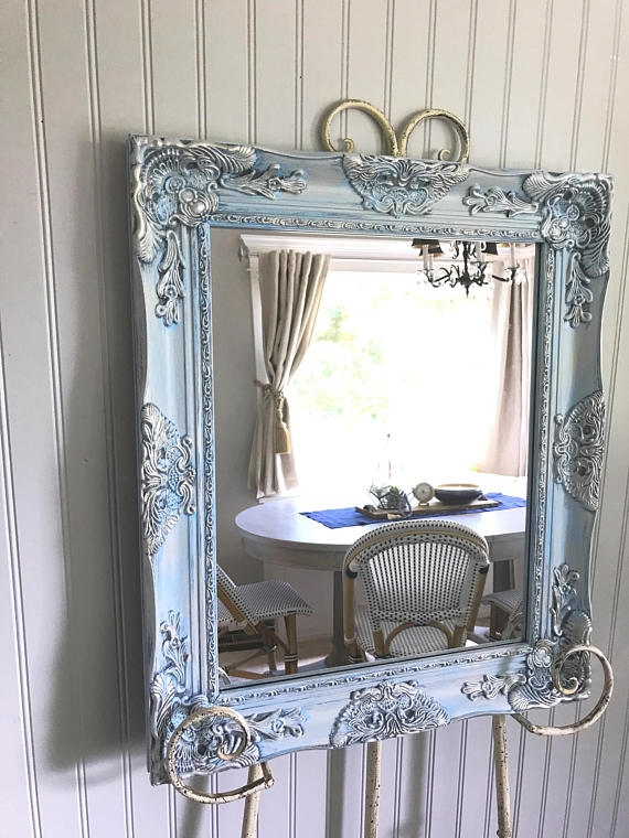 blue and silver mirror on easel
