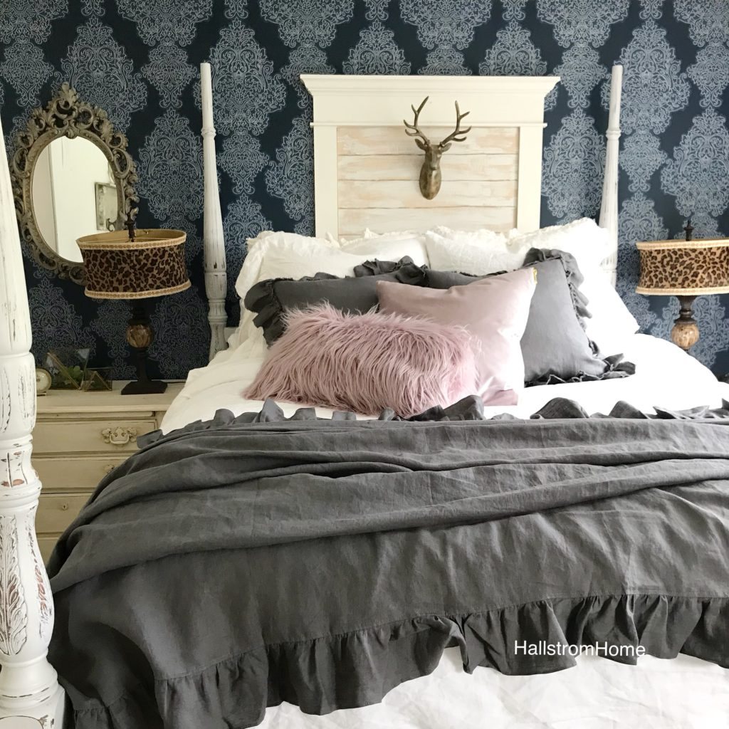 gray linen blanket ith purple pillows and gray an white pillows
