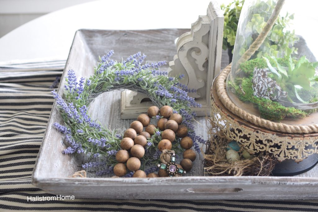 wood tray with lavender wreath and wood bead garland