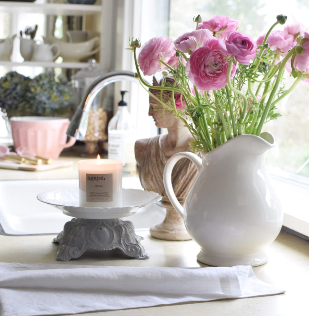 Our 100 Year Old Farmhouse Spring Tour white vase with pink flowers and white linen tea towel with platter nd white candle