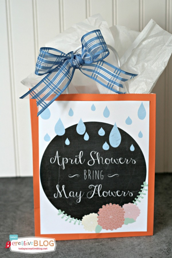 april showers bring may flowers printable with rain and flowers pasted on a gift bag