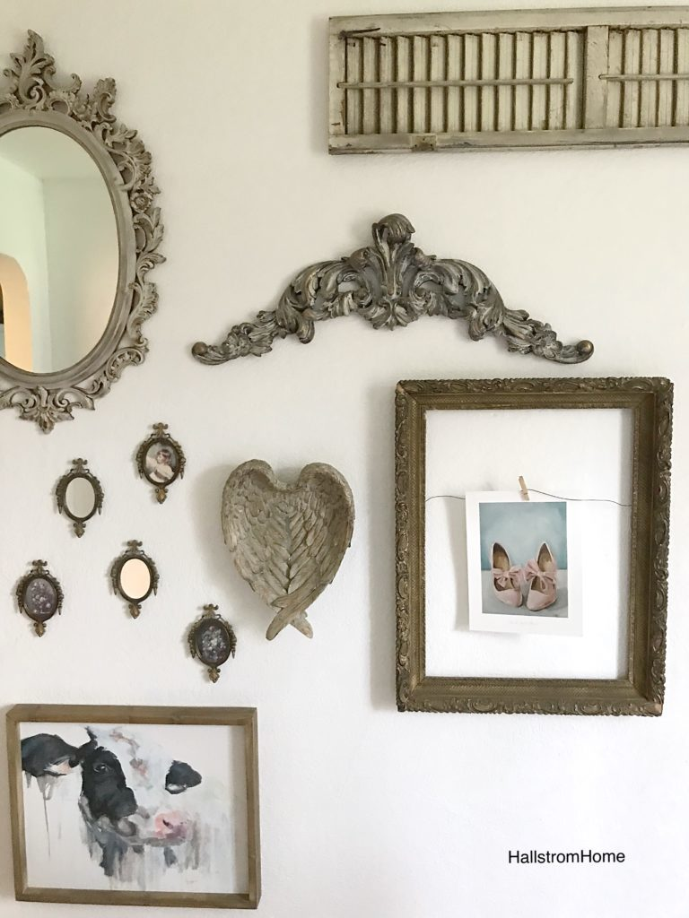 farmhouse gallery wall with frame and sall mirrors and angel wings