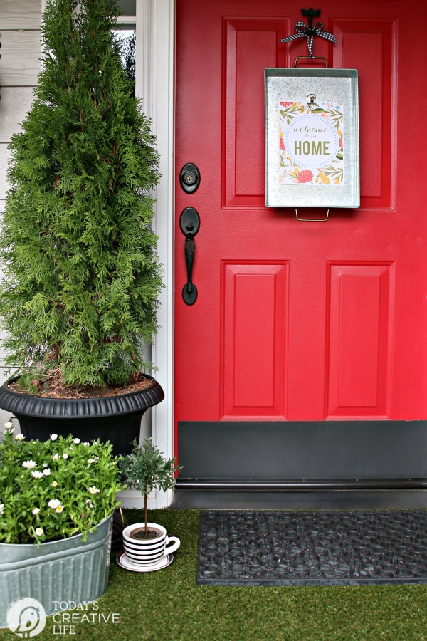 red front door with welcome to our home printable