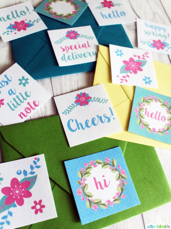colorful envelopes with little stickers scattered around