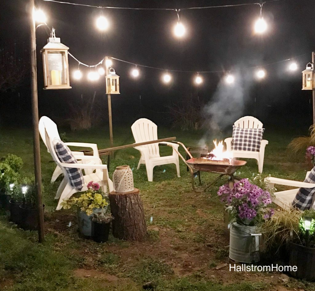 The Best Solar Powered Lighting for Outdoors white chairs around capfire and ligthing all around the edge