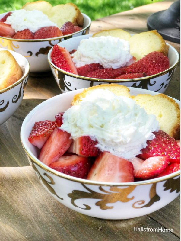 4 bowls of strawberries bread and whip cream