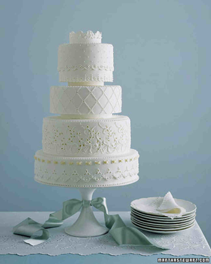 4 tier white cake with lace frosting details