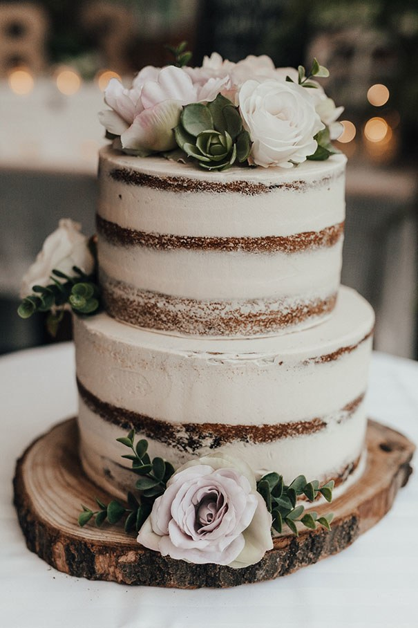 2 tier naked cake with roses and succulents