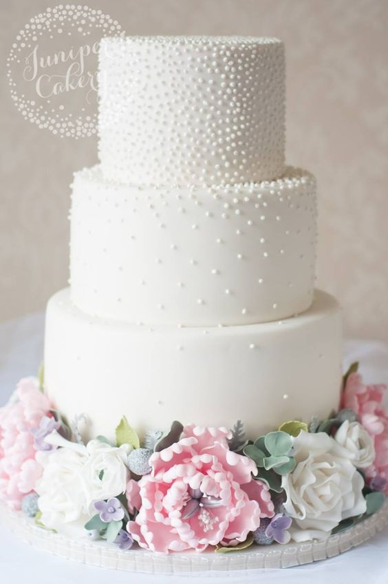3 tier white cake with pearls and pink and white foundant flowers