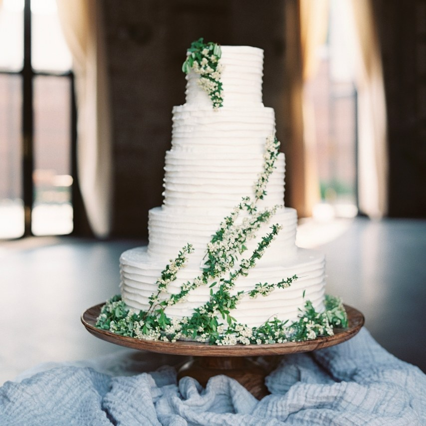 5 tier cake with green and white flowers