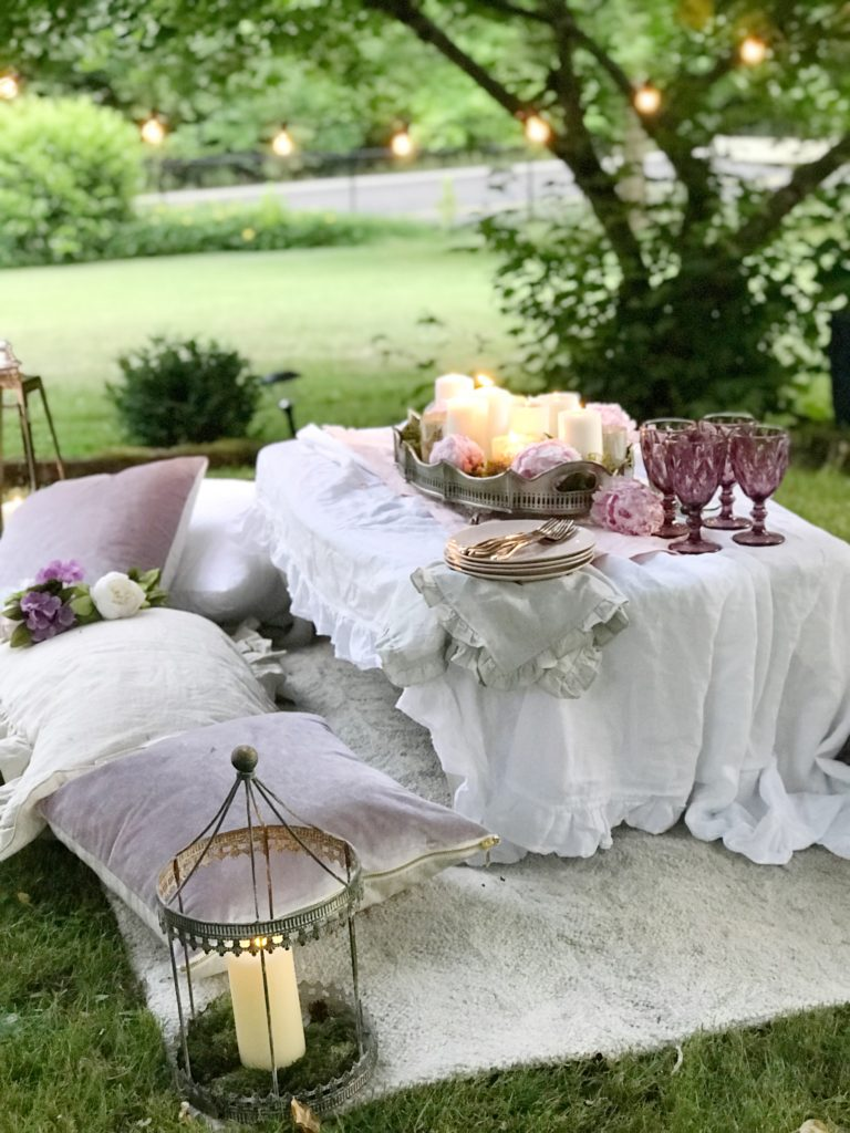 Make Your Outdoor Shabby Chic Wedding Extra Special white table on ground with pillow seating