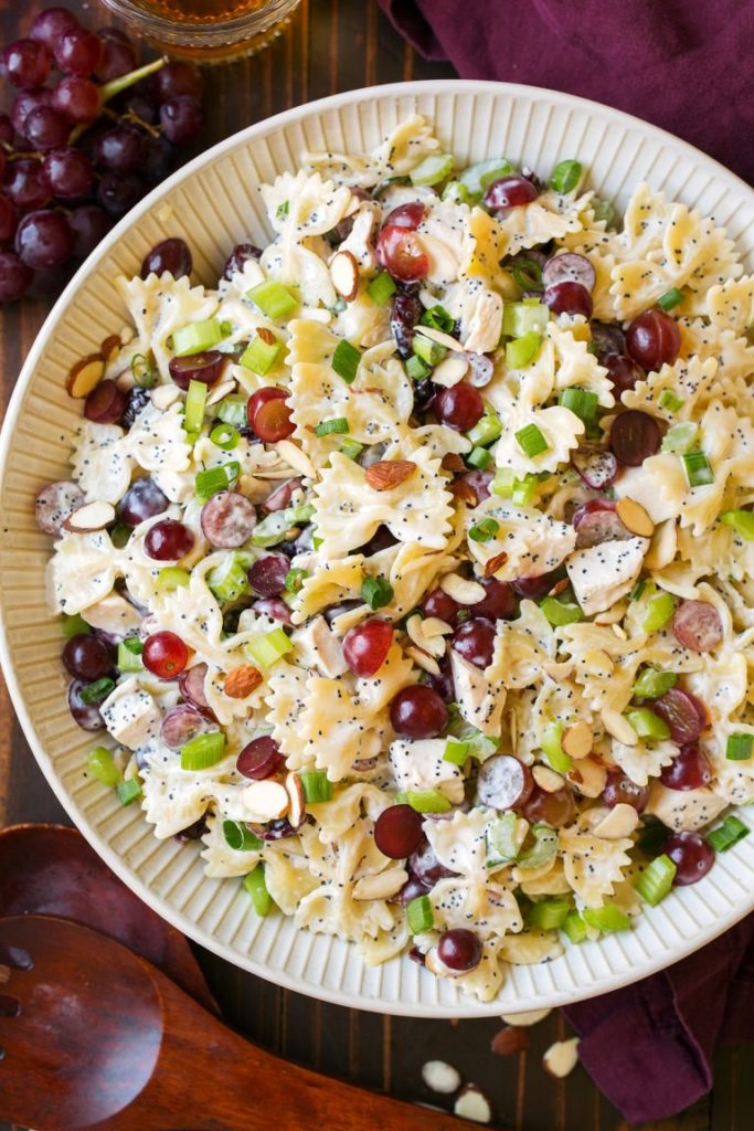 white bowl of pasta salad with grapes