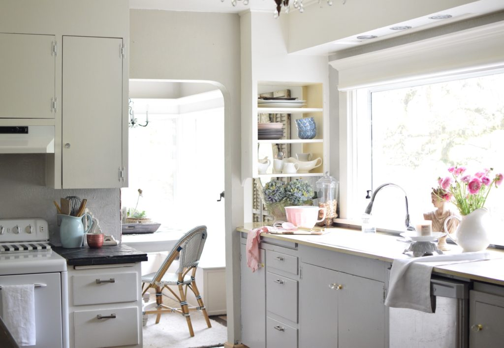 kitchen with gray cabinets and bouuet of blue flowers on counter