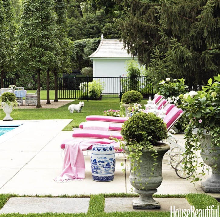 poolside with lounge chairs and boxwood planters