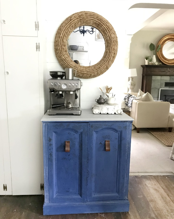 blue coffee bar with woven mirror