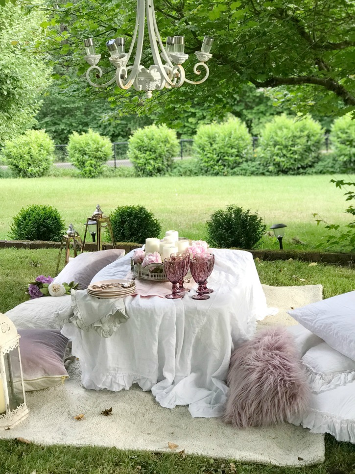 white table with purple pillows