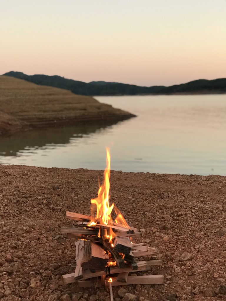 fire on the shore of lake