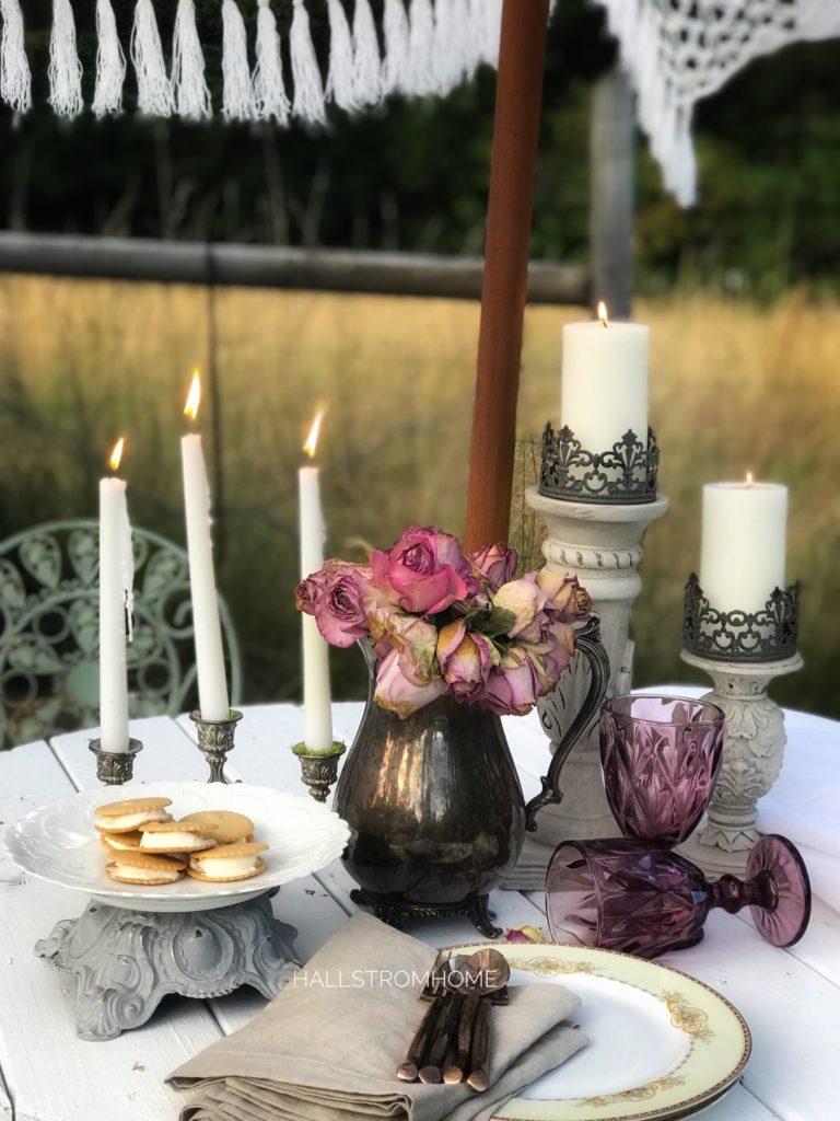 fringe umbrella with candelabra candleholders and silvervase
