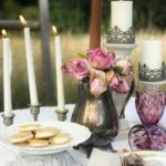 purple glasses with platter of ie cream sandwiches and vase of flowers