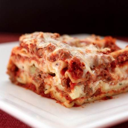 square of lasagna on white plate