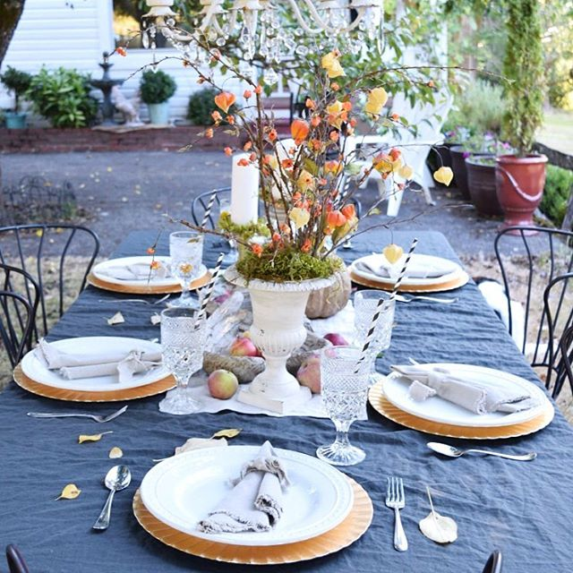 fall table outdoors with apples
