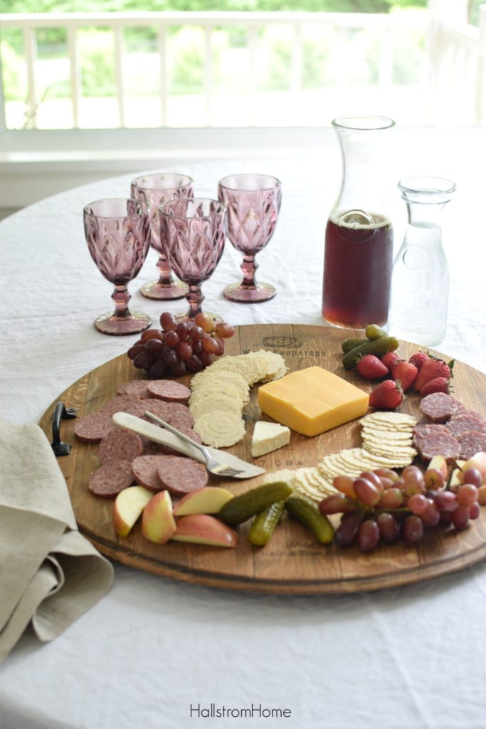 cheese platter with 4 purple cup and pitcher of iced tea