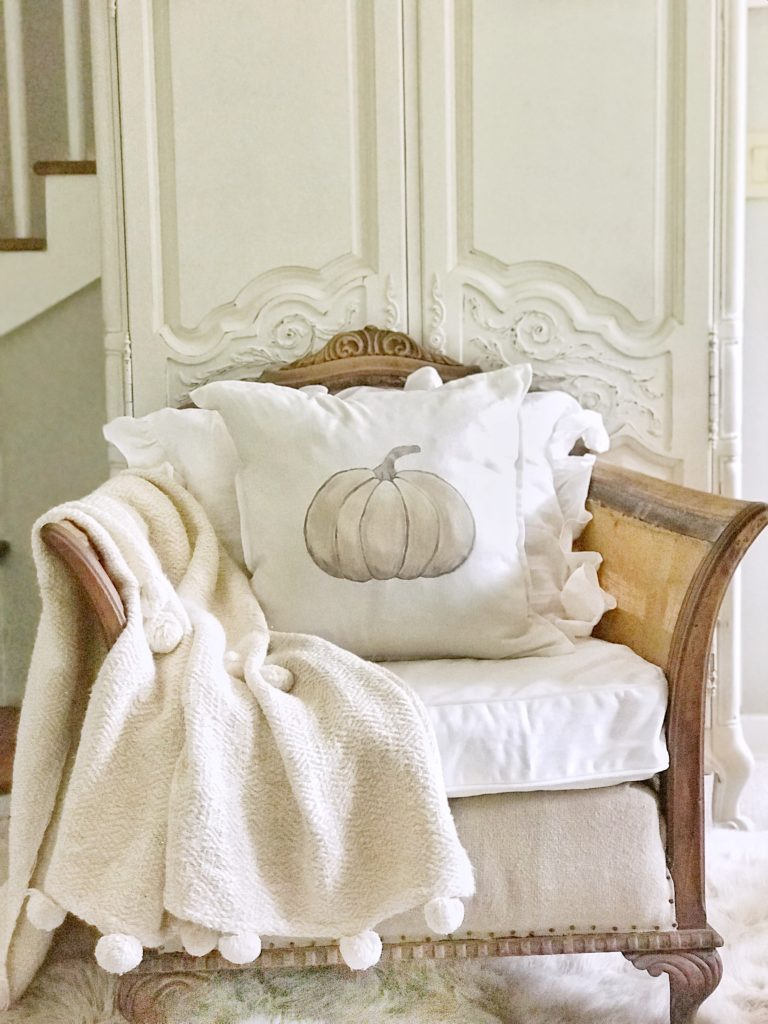 pumpkin pillow on shabby chic chair