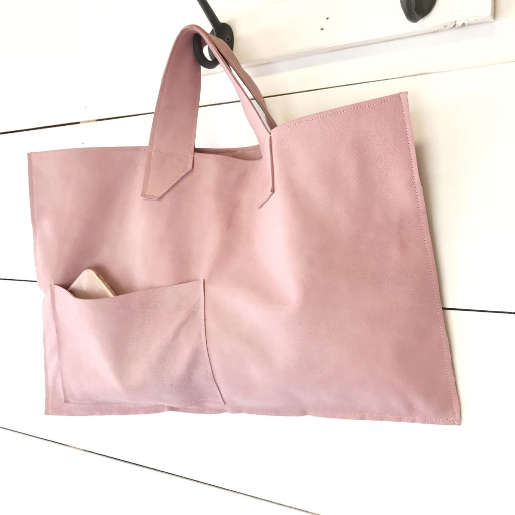 pink leather bag hanging on hook with phone sticking out of pocket |We Have a Fabulous Surprise-Launching a New Product, What Do You Think?